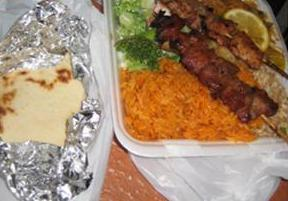 Titiyas with a plate of red rice, barbecue pork and chicken, and salad from the Chamorro Village on Guam